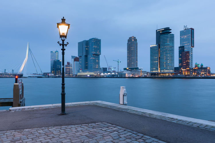 City lantern Architecture Bridge - Man Made Structure Building Exterior Business Finance And Industry City Cityscape Harbor Illuminated Landscape Modern Night No People Outdoors Rotterdam Rotterdam Harbor Rotterdam Skyline Sea Sky Skyscraper Travel Destinations Urban Skyline Water