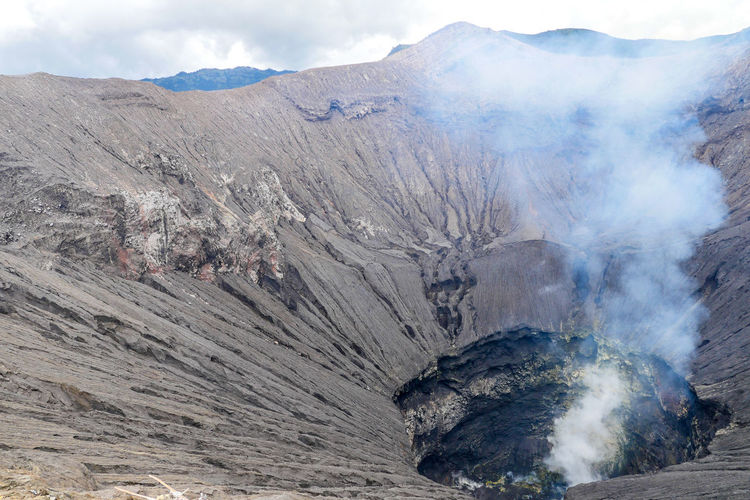Active Volcano Beauty In Nature Bromo Day Emitting Environment Formation Geology Land Landscape Mountain Mountain Peak Mountain Range Nature No People Non-urban Scene Outdoors Physical Geography Power In Nature Rock Scenics - Nature Smoke Smoke - Physical Structure Volcanic Crater Volcano