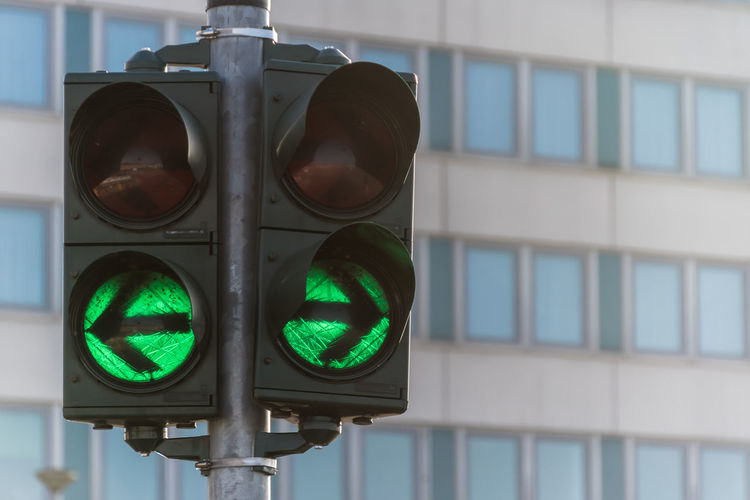 Close-up Day Green Color Guidance Illuminated Left No People Outdoors Right Road Sign Road Signal Safety Stoplight Traffic Lights Transportation