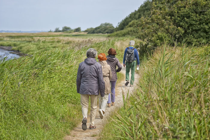 go for a walk nature hike Nature Hike Backpack Baltic Coast Baltic Sea Balticsea Casual Clothing Countryside Field Go For A Walk Grass Green Hike Hike Path Hiking Hiking Trail Landscape Leisure Activity Nature Path Person Togetherness Trail Walk Walking