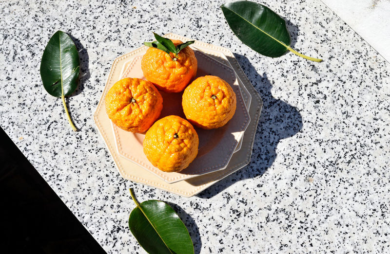 oranges and leaves on the background a granite Andalucía Bright Lights Citrus Fruit Food Fruits Indulgence Oranges Organic Sunlight