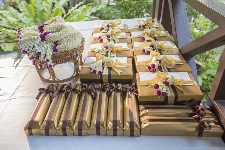 High angle view of gift boxes by flowers on table during wedding