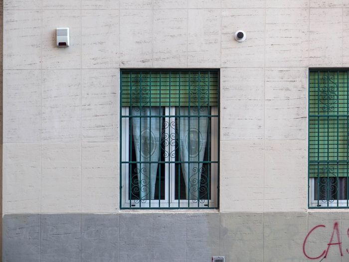 Alarm Device Aluminum Window Architecture Building Building Exterior Building Exteriors Built Structure Curtains Day Glass Grating Green House Facade House Window No People Outdoors Railing Shade Stone Wall Window Window Frame Window Front Window Glass Window Shade Windows