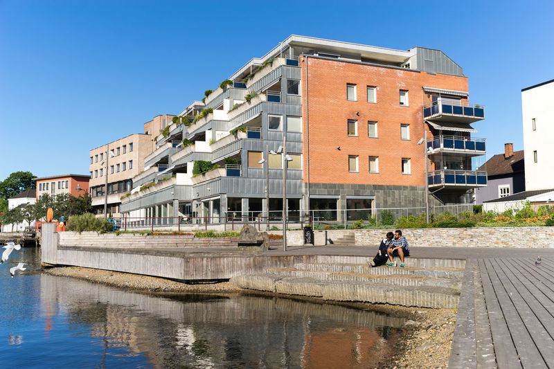 Riverside Architecture Blue Sky Building Exterior Built Structure City Clear Sky Day Outdoors Porsgrunn Residential Building Sky Strandpromenaden Telemark Water Water Reflections Waterfront