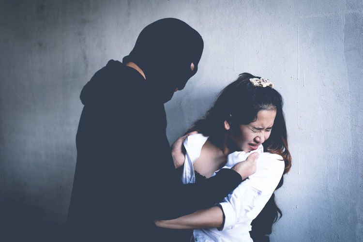 Criminal Holding Woman Against Wall
