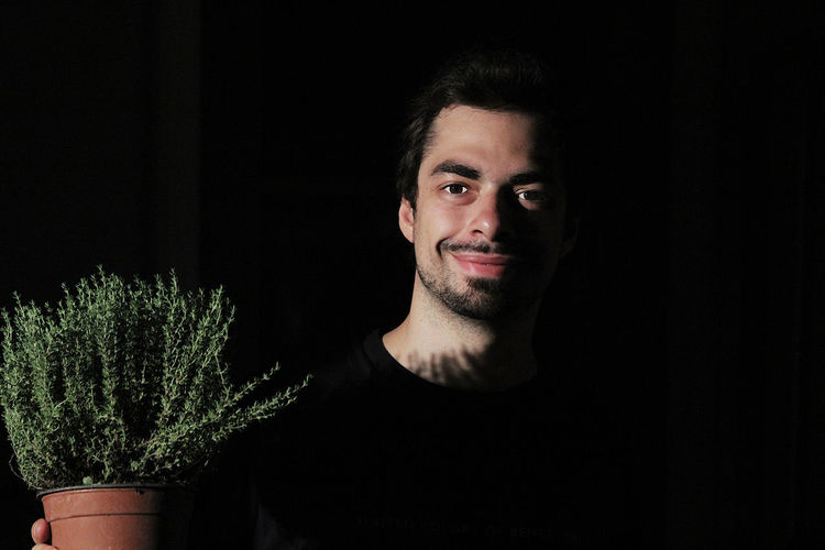 Adult Beard Black Background Close-up Growth Indoors  Looking At Camera One Person People Plant Portrait Smiling Studio Shot Tree Young Adult