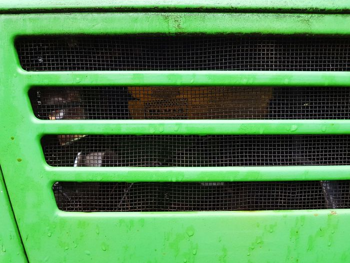 Gridded green piece of a vehicle Vehicle Textured  Waterdrops Old Metal Grunge Machinery Backgrounds Full Frame Technology Close-up Green Color