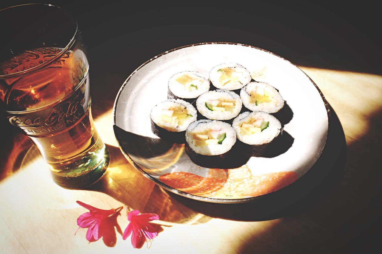 Sushi Served With Glass Of Cold Drink
