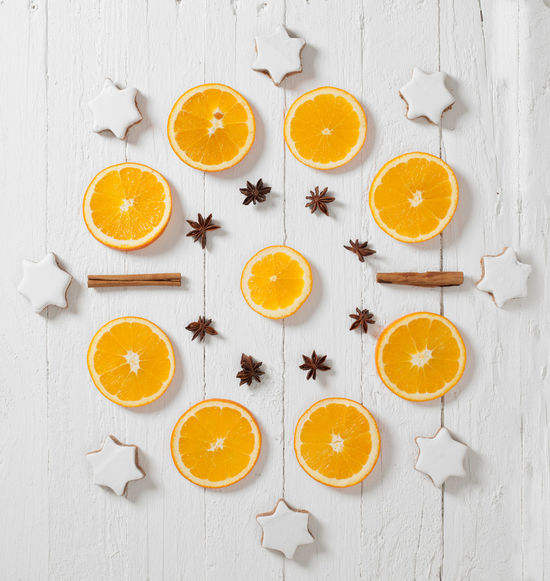 Pattern made of oranges, cinnamon stars and star anise Arrangement Citrus Fruit Cross Section Food Food And Drink Freshness Fruit High Angle View Indoors  No People Orange - Fruit SLICE Star Anise Studio Shot Table
