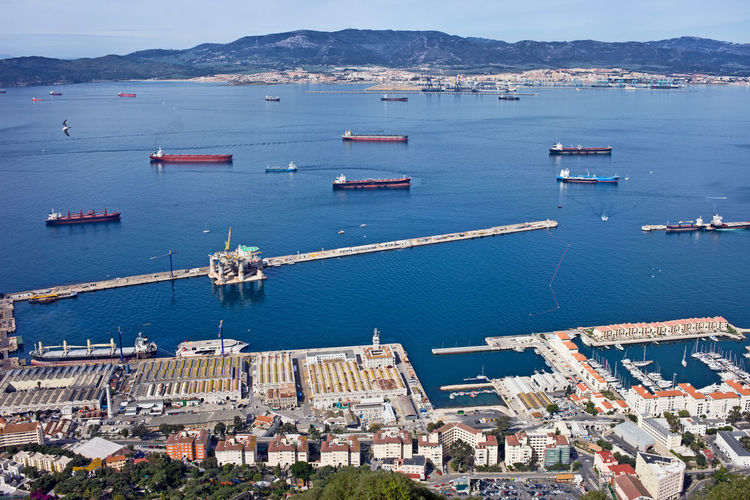 Gibraltar quay from above, cargo ships on sea bay British Overseas Territory Cargo Ship Mediterranean Sea Pier Aerial View Architecture Bay Building Exterior Built Structure City Cityscape Commercial Dock Europe Gibraltar Harbor High Angle View Nautical Vessel Port Quay Sea Ship Transportation Water Waterfront Wharf
