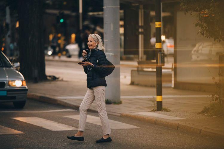 Full length of man standing on street at night