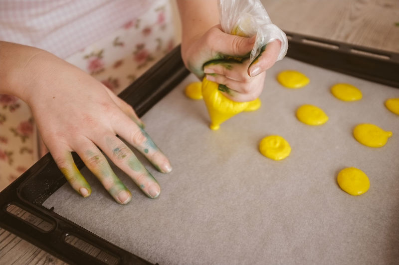 Close-up of woman baking cookies