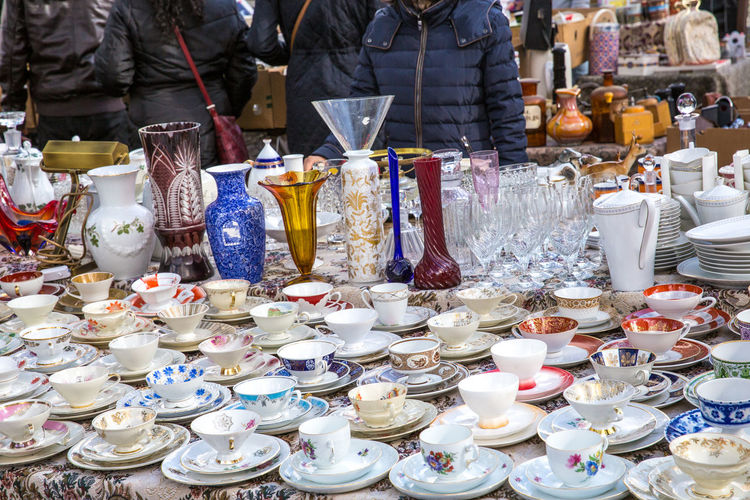 Cups arranged at market for sale