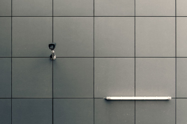Full frame shot of building facade with security camera