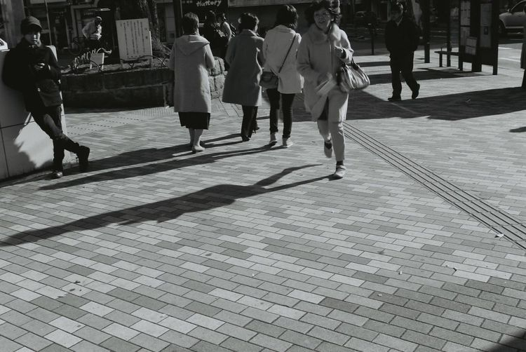 Canon Film EOS1 Filmphotography 35mm Film 35mm Japan Kyoto People Watching Streetphoto_bw Monochrome Black And White Blackandwhite Light And Shadow Streetphotography Street People Peoplephotography Peoples Photography In Motion Urban Spring Fever People Photography Run Runner