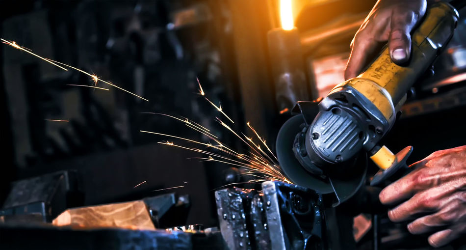 Human Hand Hand Occupation Working Heat - Temperature One Person Blurred Motion Motion Human Body Part Fire Real People Burning Fire - Natural Phenomenon Workshop Metal Holding Work Tool Industry Indoors  Sparks Skill  Metal Industry Finger Welding Steel