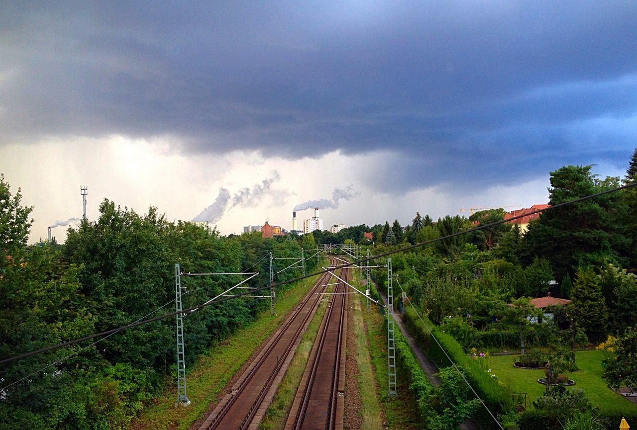 High angle view of railroad tracks against storm clouds
