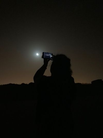 Moonlight Silhouette Sky Technology Night Copy Space Photography Themes HUAWEI Photo Award: After Dark Nature Wireless Technology Holding Photographing Activity Communication Outdoors People Camera - Photographic Equipment Leisure Activity Real People EyeEmNewHere