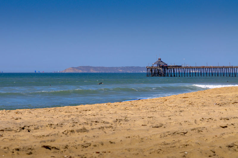 Imperial Beach, Pier, Coronado Island and Downtown San Diego Architecture Beach Beauty In Nature Blue Building Exterior Built Structure Clear Sky Copy Space Day Imperial Beach Imperial Beach Pier Land Nature Outdoors Pier Sand Scenics - Nature Sea Sky Tranquility Travel Water