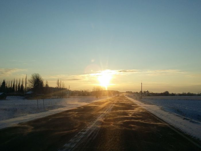 Beauty In Nature Cold Temperature Covering Idyllic Landscape MeinAutomoment Nature No People Non-urban Scene Outdoors Road Scenics Season  Sky Snow Snow Covered Sun Sunbeam Sunlight Sunset The Way Forward Tranquil Scene Tranquility Weather Winter