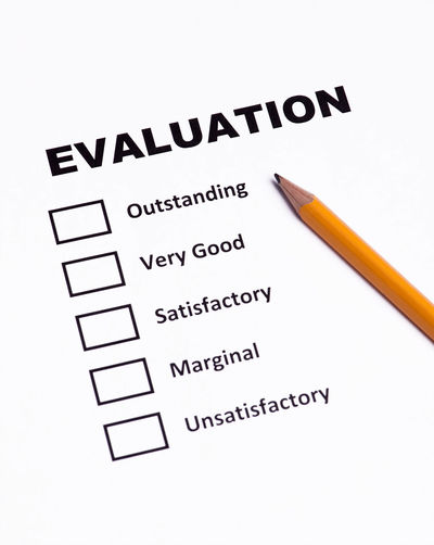 Evaluation Form Evaluation Form Close-up Complaint Concept Customer  Evaluate Feedback Grading No People Paper Pencil Questionaire Rating Report Satisfactory Level Studio Shot Survey Text White Background Writing