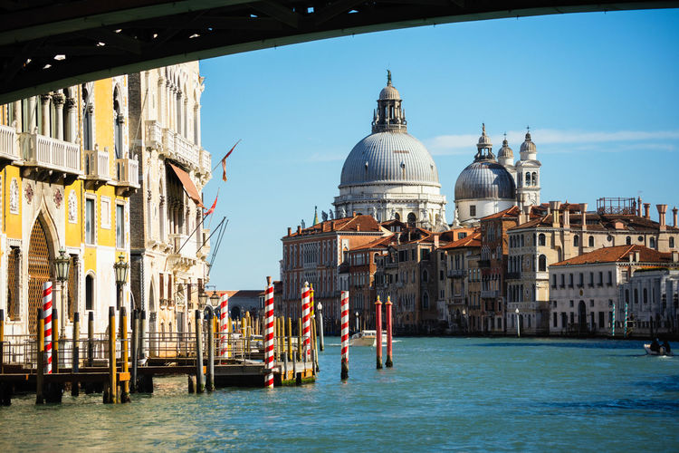 Santa Maria della Salute Building Exterior Architecture Built Structure Religion Building Place Of Worship Water Sky Belief Travel Destinations Canal Dome Nature Travel Spirituality Tourism Waterfront Day No People Outdoors Wooden Post Santa Maria Della Salute Church