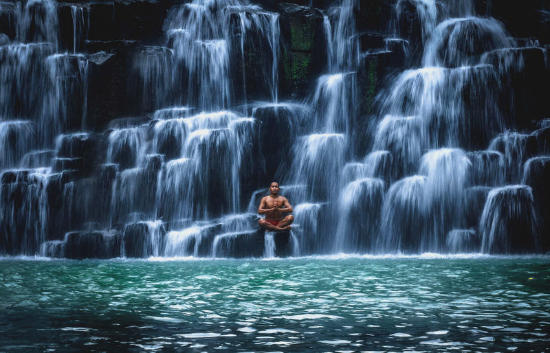 Shirtless Man Doing Yoga At Bulingan Falls