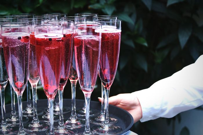 Red Drinks in Champagne Glasses . Tablet Serving Wedding Photography Drink Alkohol Fresh On Market 2018