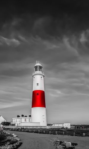 Dreamy world Lighthouse Sky Cloud - Sky Guidance Building Exterior Architecture Direction Tower Built Structure Safety Outdoors Day Sea No People Nature Beach