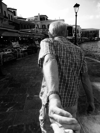 i followed my dad through the harbor of Chania...The Following The Follower Fresh On Eyeem  Black & White Monochrome Black And White Blackandwhite Man Hand Holding Hands Crete Greece Chania Travel Travelling