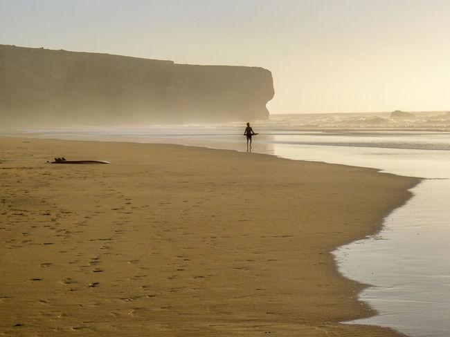 Amoreira Beach Skimboarding Surf Algarve, Portugal Beach Boy On Beach People Sand Sea