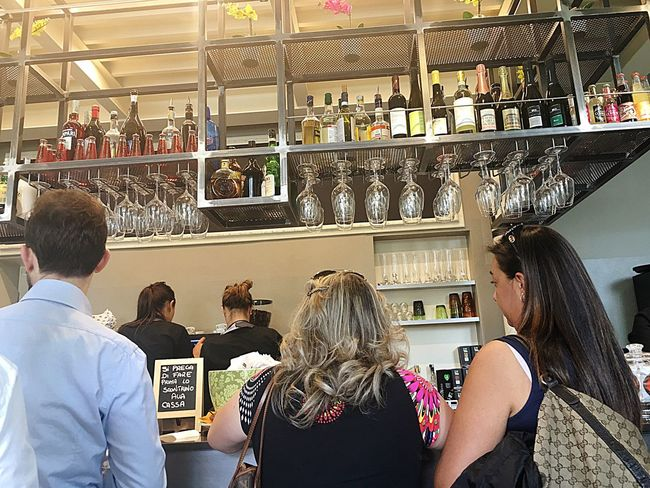 The Following Having Breakfast at a Cafe On Sunday Morning People Enjoying Life Bar Design Wine Crowded Place Glasses Spirits Drinks And Bottles Juices Appetizers
