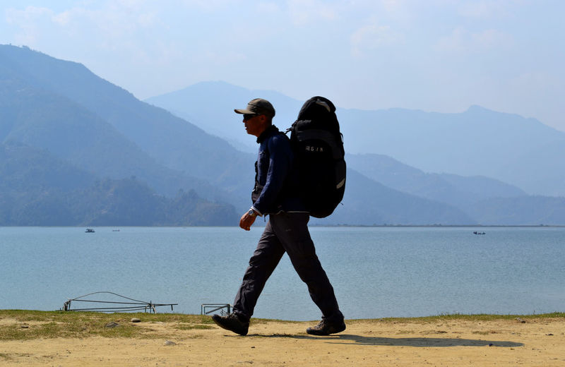 walking by the Phewa Lake One Person Traveller Big Bag Pokhara, Nepal