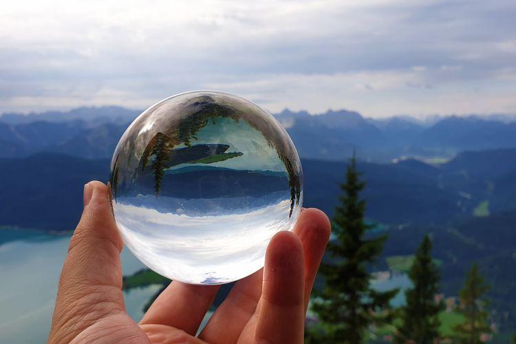 Lake walchensee reflecting in a crystal ball