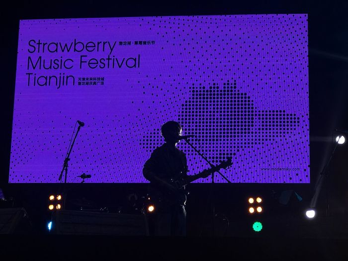 Silhouette Arts Culture And Entertainment Men Real People Performance Music Night Standing Stage - Performance Space Occupation Musician Nightlife Microphone One Person Illuminated Indoors  Stage Light Electric Guitar Technology Adult