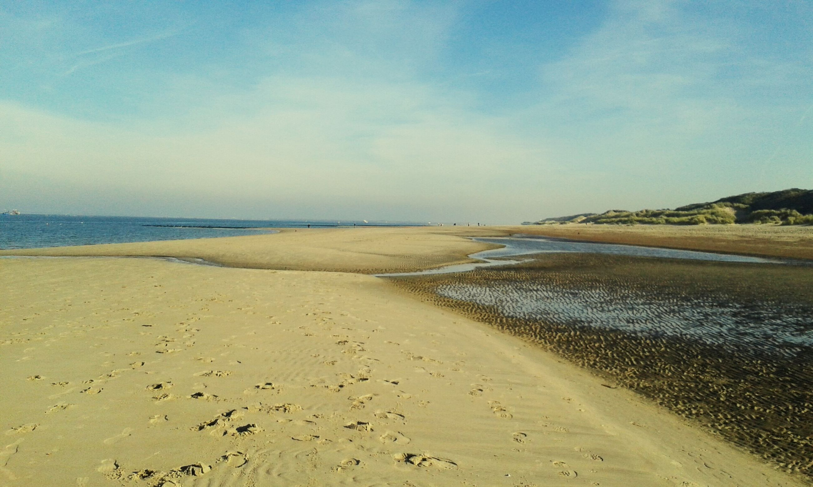 beach, sand, water, sea, tranquil scene, shore, tranquility, scenics, sky, beauty in nature, nature, horizon over water, coastline, idyllic, blue, outdoors, calm, day, remote, non-urban scene