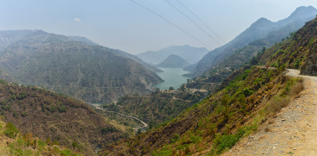 Chamera Dam (lake ) Dalhousie EyeEmNewHere Beauty In Nature Cable Chamba Chamera Lake Day Environment Himachalpradesh Idyllic Land Landscape Mountain Mountain Peak Mountain Range Nature No People Non-urban Scene Outdoors Plant Road Scenics - Nature Tranquil Scene Tranquility Valley