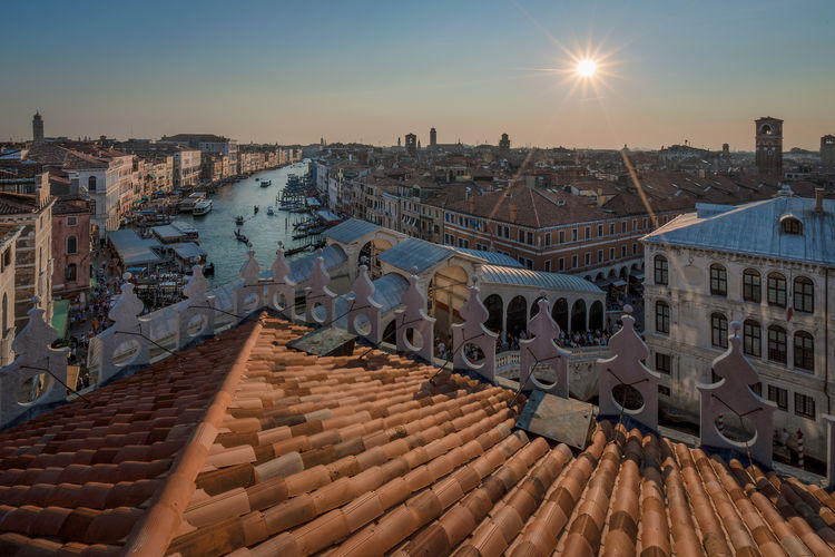 High angle view of grand canal amidst buildings against sky during sunset