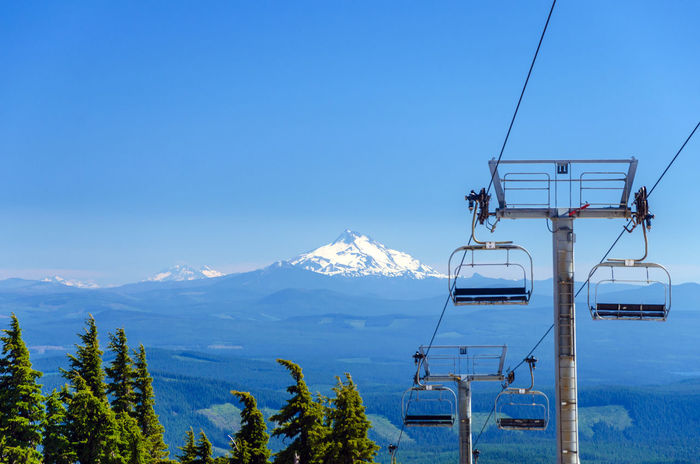 View of chairlifts on Mt. Hood with Mount Jefferson in the background in Oregon Cable Cascade Chairlift Forest Hills Landmark Landscape Lift Magic Mount Hood Mountain MtHood Nature Northwest Oregon Outdoors Pacific Range Rocks Skilift Summer Timberline Trees View Wilderness
