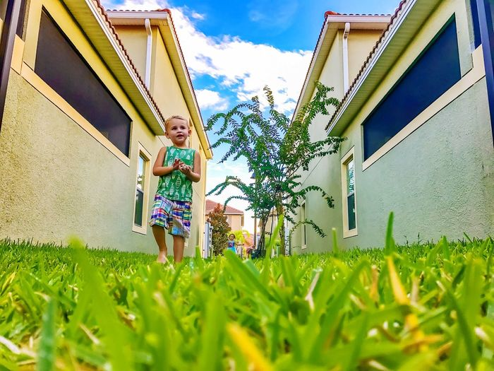Dramatic Angles Photo 3 of 3. Week 1 of 10 assignment Kris Slater Grass Building Exterior Growth Day House Outdoors Person Focus On Background Sky Boy Twins 3 kids all together. Find third way in the background. Lol Field Toddler  Son EyeEm Eyeem School Of Photography
