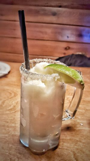 Frozen margarita in a chilled mug with a salted rim and lime wedge Relaxing Hanging Out Frozen Drinks Margaritas