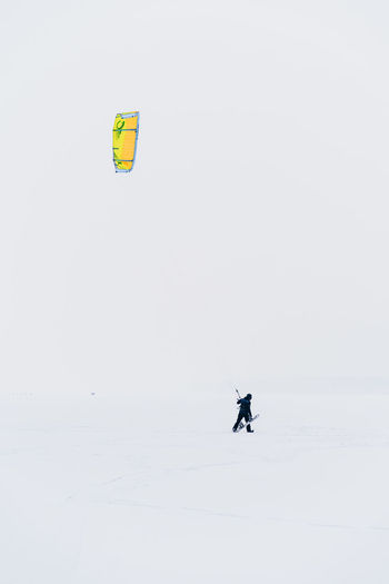 Sport Adventure Extreme Sports Leisure Activity Outdoors Winter Sport Winter Kiteboarding Snowboarding Exploration Kitesurfing Kitesurfer Snow Frozen Lithuania Kaunas Snowstorm Alone Brave Extreme Weather Freedom Beauty In Nature Cold Temperature One Person Kite