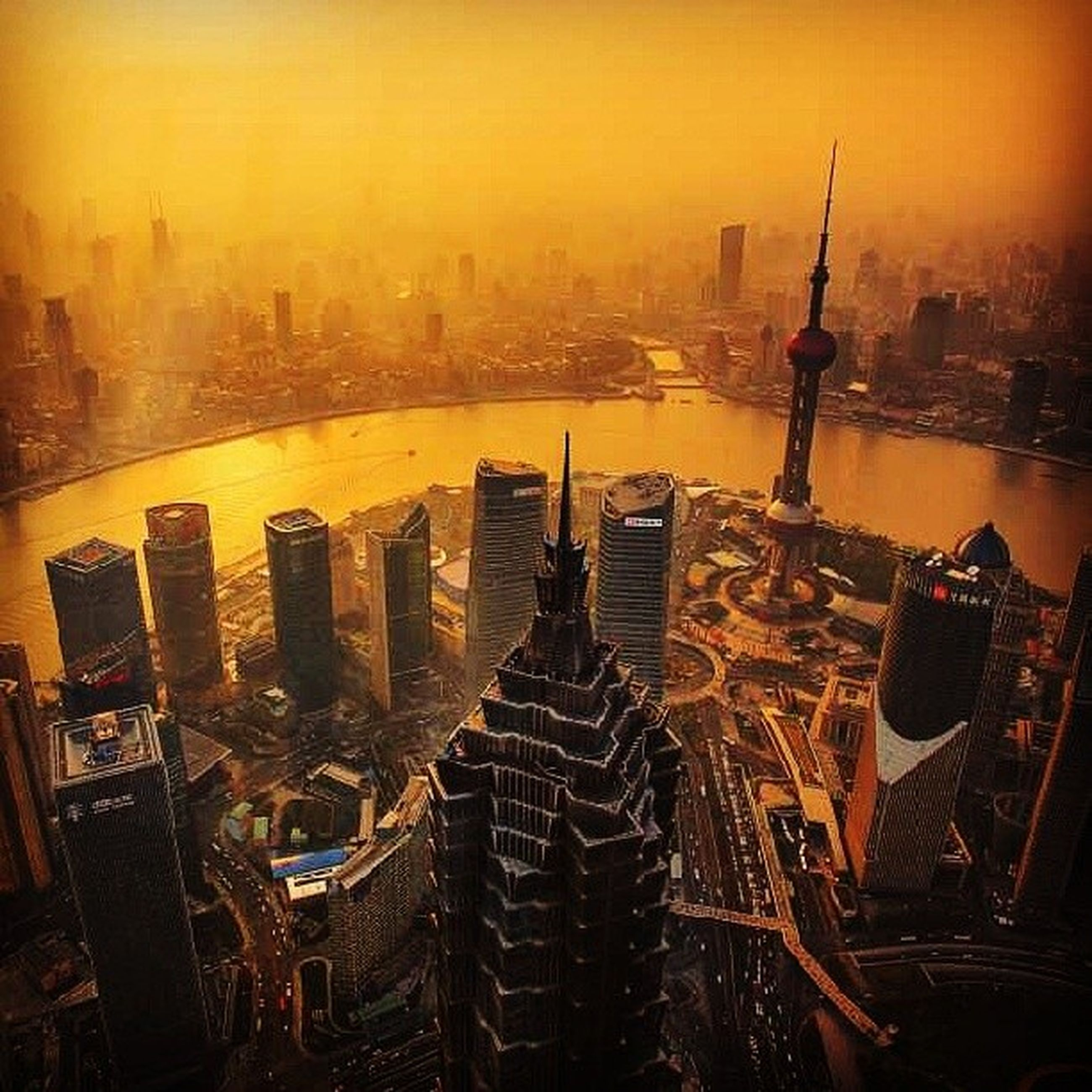city, cityscape, building exterior, sunset, built structure, architecture, water, high angle view, transportation, skyscraper, nautical vessel, river, harbor, city life, mode of transport, development, crowded, sky, outdoors, tall - high