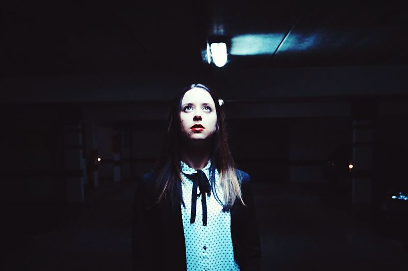 Portrait of woman standing at night