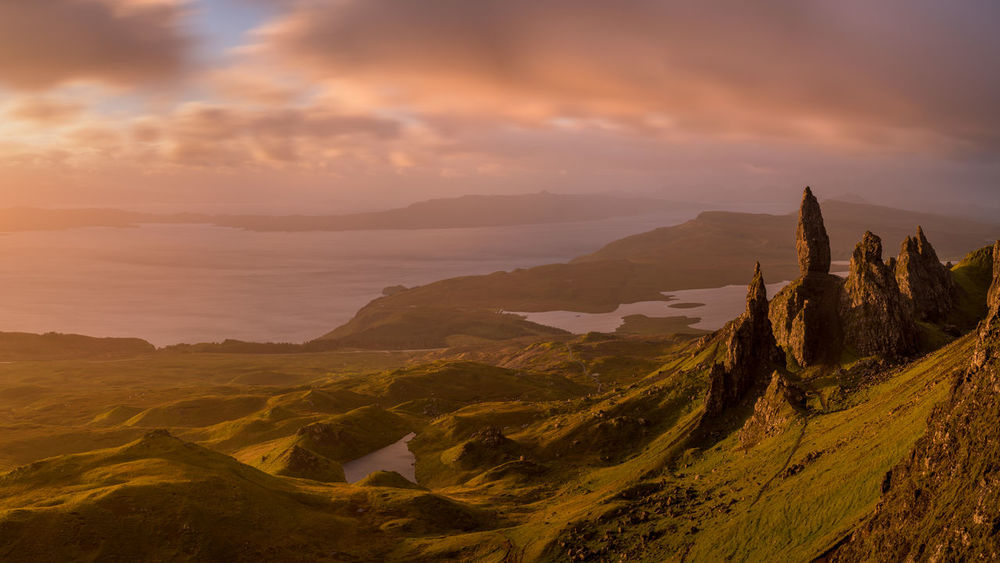 Old Man of Storr sunrise panorama. In a windy day with weather changing fast in the morning the sky gave us some nice colors Colors Green High Resolution Magical Morning Old Man Of Storr Scotland Travel Cliff Clouds Day Daylight Green Hills Higlands Scotland Hikking Isle Of Skye Landscape Mist Movie Location No People Prometheus Sunrise Tourism Travel Destinations Valleys