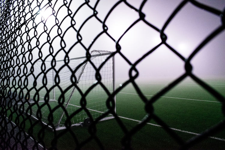 When fog stopped play Selected For Premium Fog Soccer Sport Full Frame Backgrounds Chainlink Fence Close-up Fence Seamless Pattern Soccer Field Diamond Shaped Goal Post Foggy Soccer Goal Net - Sports Equipment Textured  Playing Field Pattern Mist