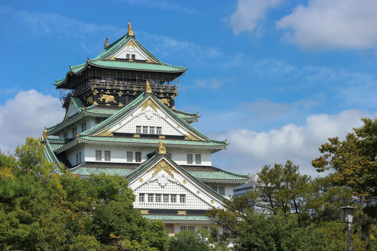 OSAKA castle with natural green park view Castle High Japan OSAKA Tourist Travel Architecture Building Building Exterior Built Structure Cloud - Sky Culture Day Daylight Nature No People Old Outdoors Palace Plant Sky Tourism Traditional Travel Destinations Tree