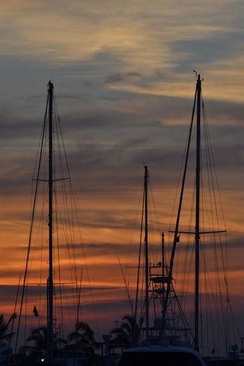 Se pinta La Marina Atmosphere Beauty In Nature Boat Cloud Cloud - Sky Colombia Dramatic Sky Majestic Mast Mode Of Transport Nature Nautical Vessel Orange Color Outdoors Sailboat Santa Marta, Colombia Scenics Silhouette Sky Sun Sunset Tourism Tranquil Scene Tranquility Transportation