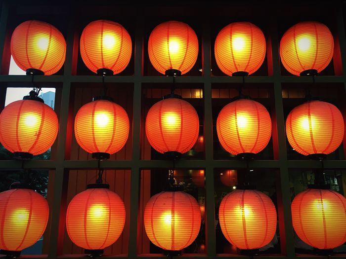 Full frame shot of illuminated japanese lanterns outside house at night