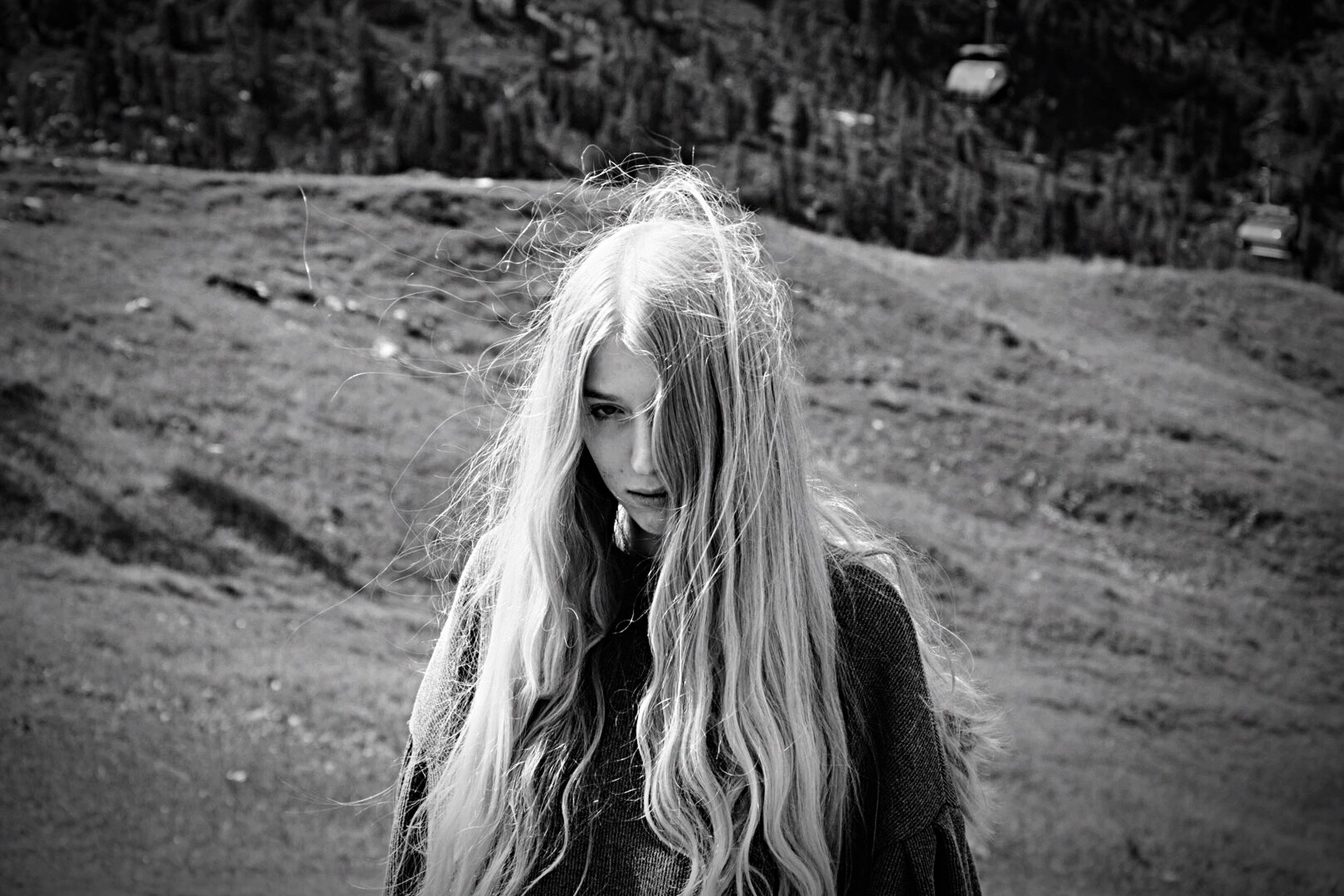 blond hair, long hair, focus on foreground, front view, one person, young adult, day, real people, young women, outdoors, nature, people